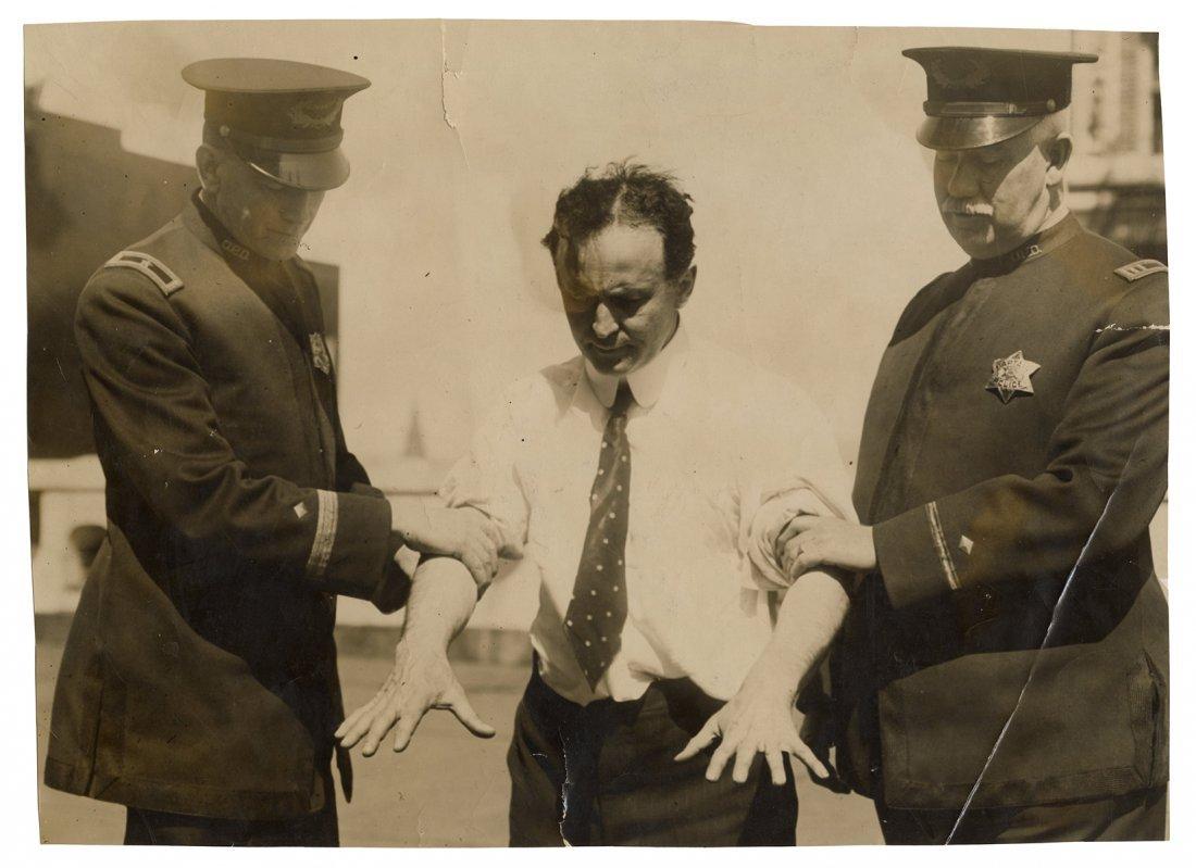 Houdini, Harry. Photograph of Houdini with Police
