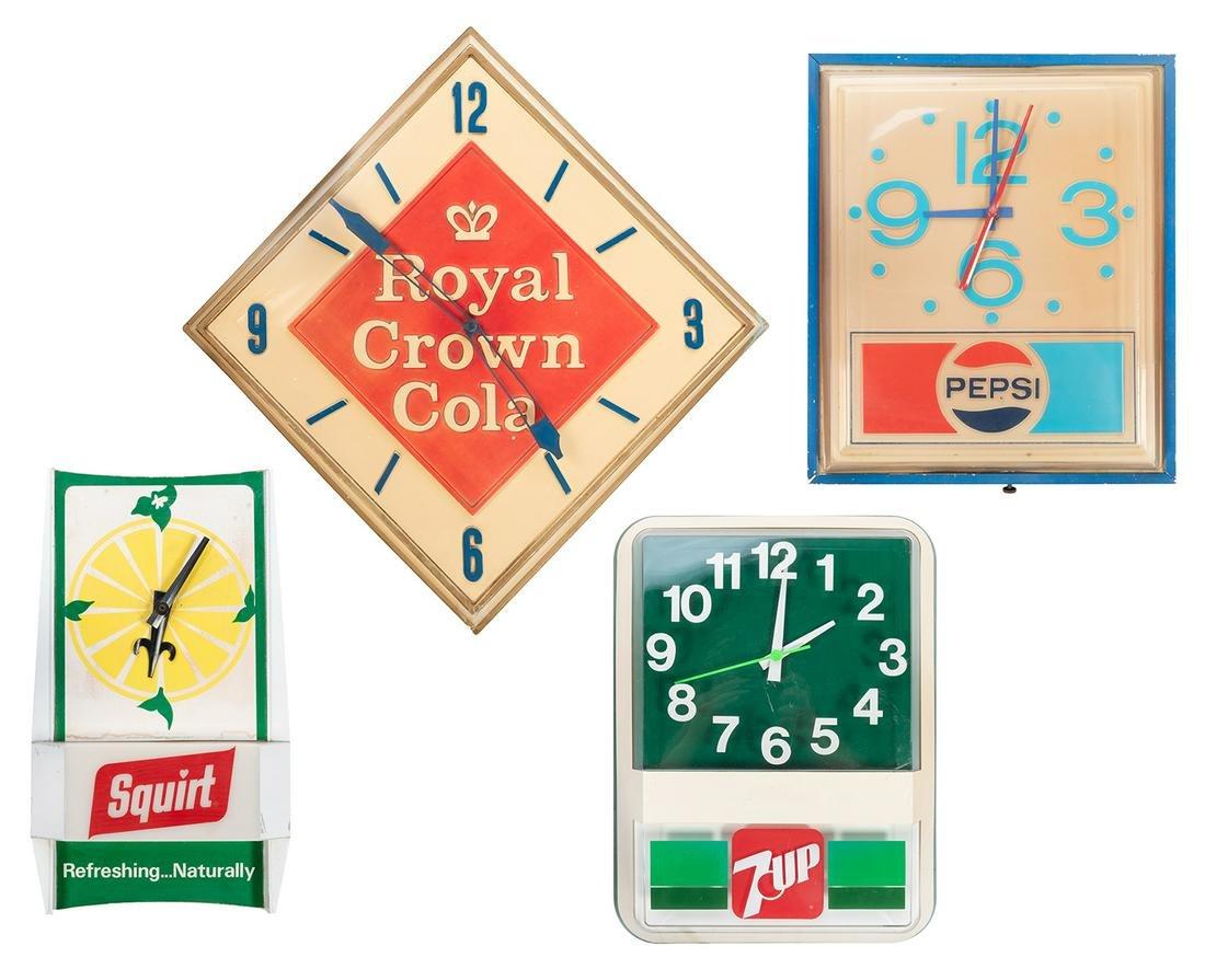 Four Vintage Soda Advertising Clocks. Circa 1970s.