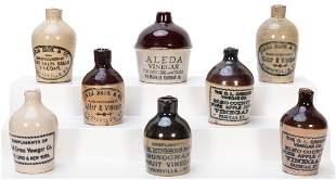 Eight Miniature Vinegar Advertising Stone Jugs.