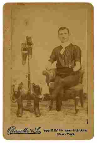 Cabinet Photo of a Man Posing with Prosthetic Arms and