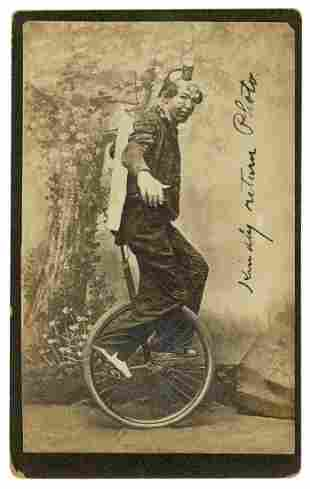 Cabinet Photo of a Clown Unicyclist. N.p., ca. 1900s.