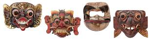 Four Wooden Indonesian Masks. Hand painted, one with