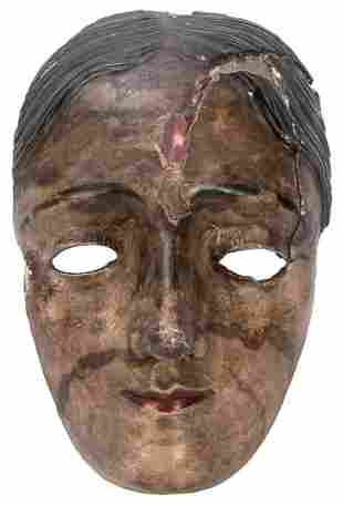 A Mexican Mask. Wood, plaster, paint, cloth. Height 7