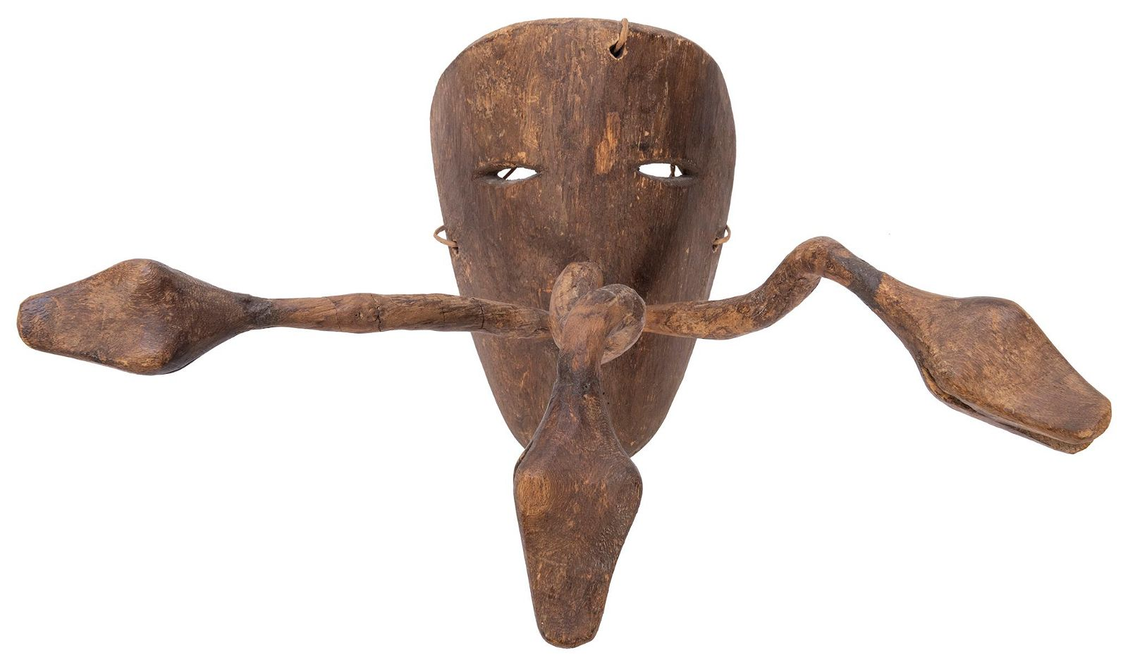 A Mexican Festival Mask. Wood. With eye slits and three