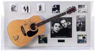 Simon and Garfunkel Acoustic Guitar and Album Display.