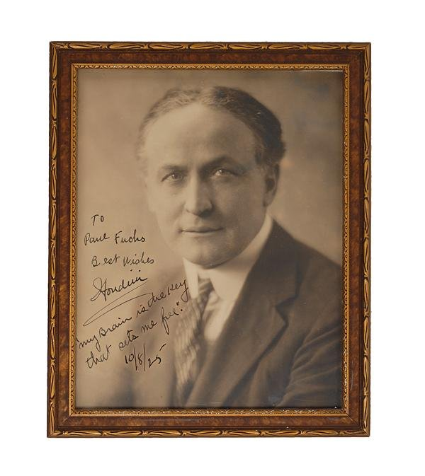 307: Bust portrait of Houdini, signed and inscribed.