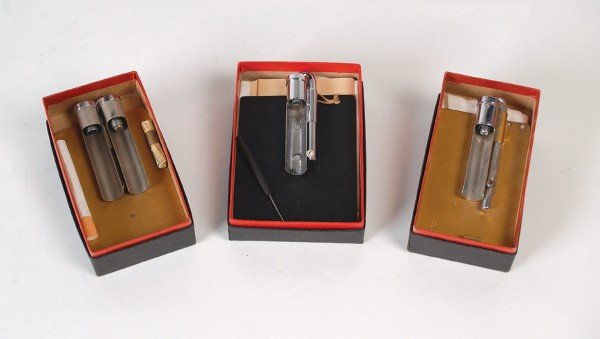 19: Three Merv Taylor cigarette loading devices