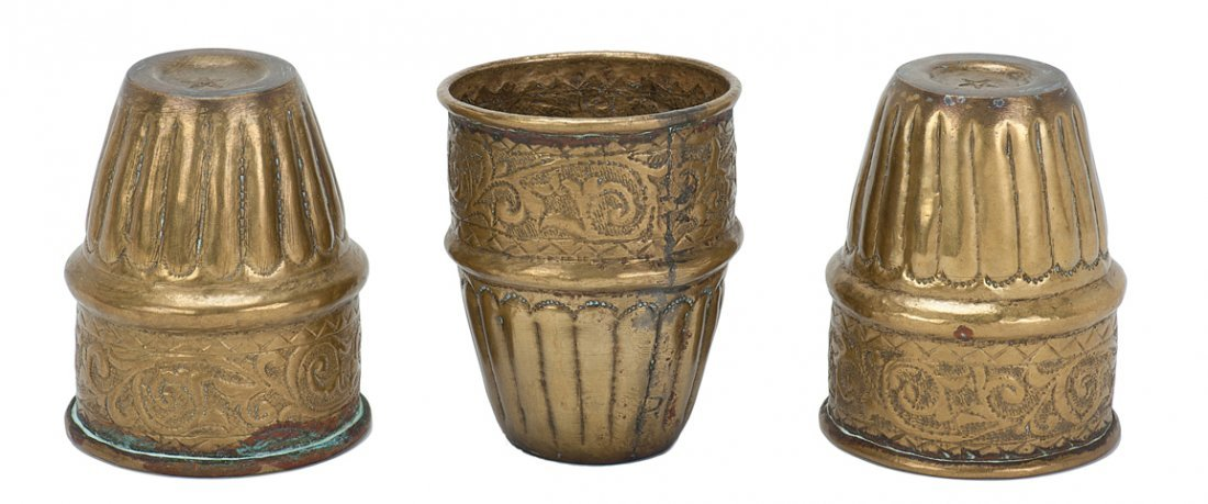 11: Set of three hammered brass cups with pentagram