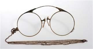 Cardini's folding pince-nez glasses.