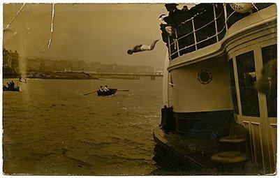 Houdini, Harry. Real photo postcard picturing Houdini