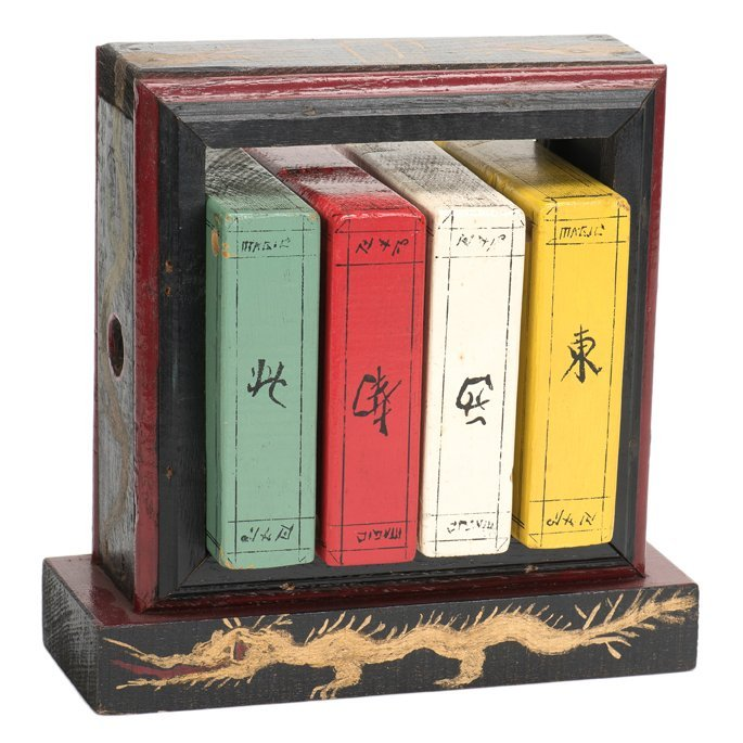 Books of Ching Soo. Four faux wooden books are tied in