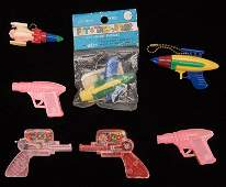 Group of Seven Ray Gun and Rocket Vintage Plastic Toys.