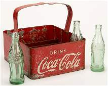 Coca-Cola Bottle Carrier and Three Green Glass Bottles.