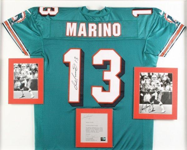 165: Dan Marino signed Dolphins jerseys, helmet etc