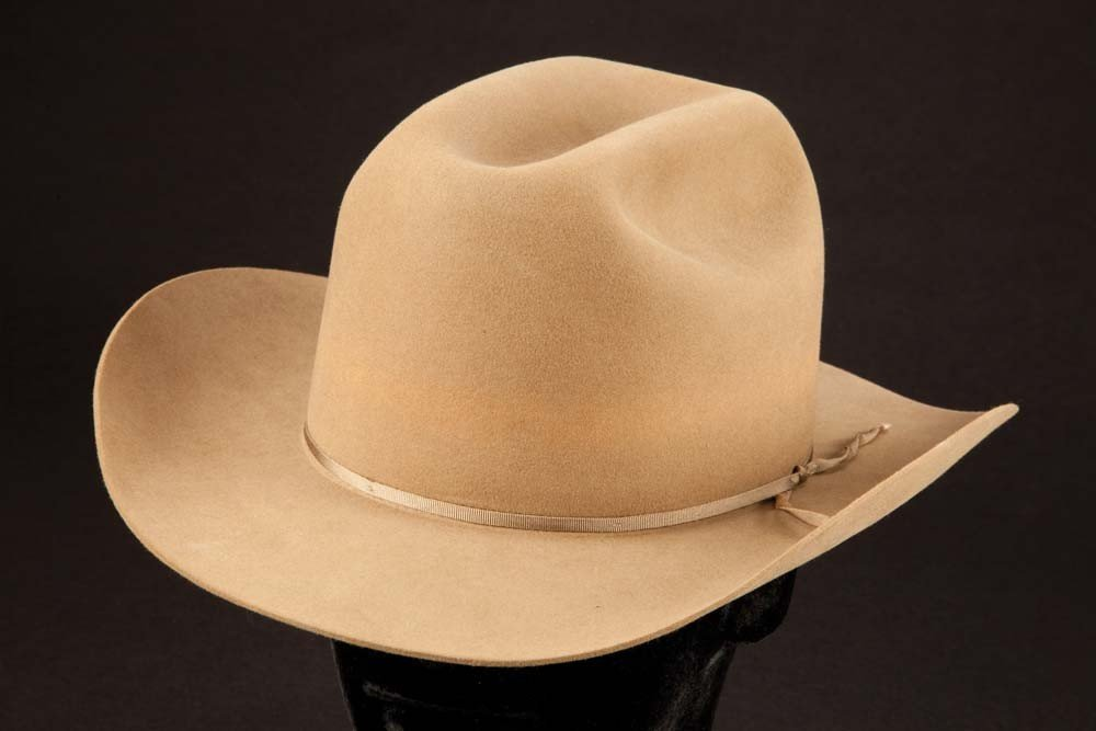 Glenn Ford's personal cowboy boots and cowboy hats