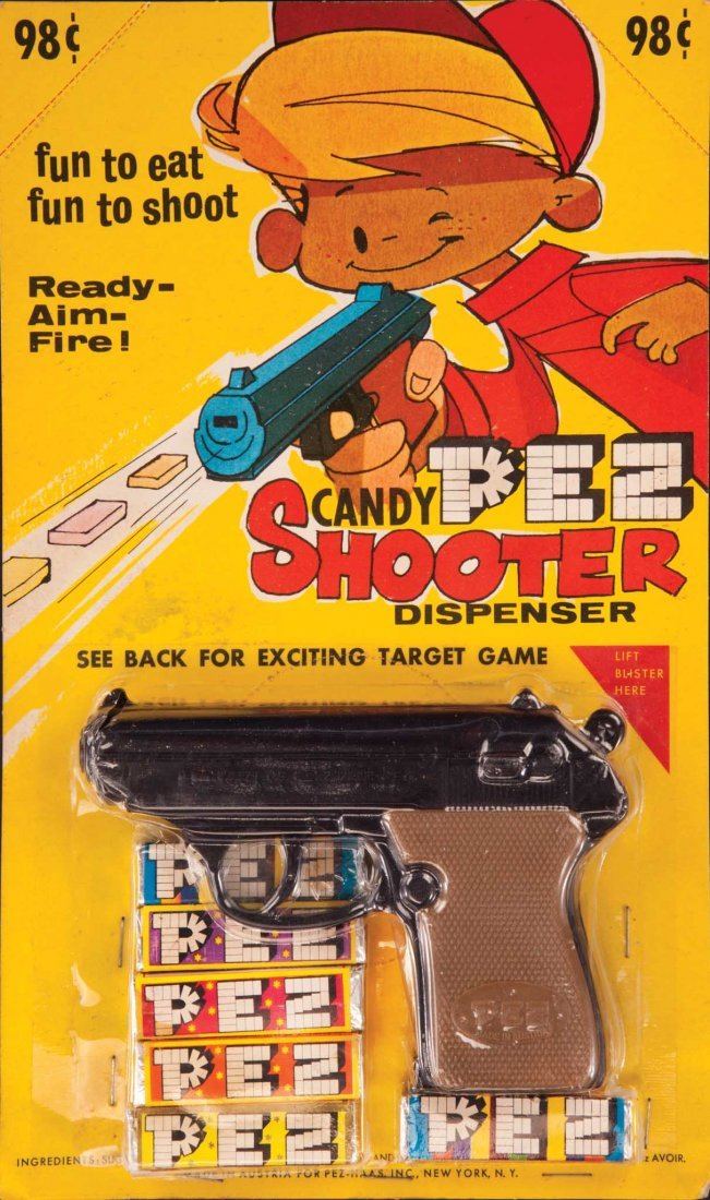 303: 1965 PEZ CANDY SHOOTER GUN MINT ON CARD