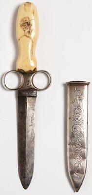 1023: Rare Michael Price ring grip dagger