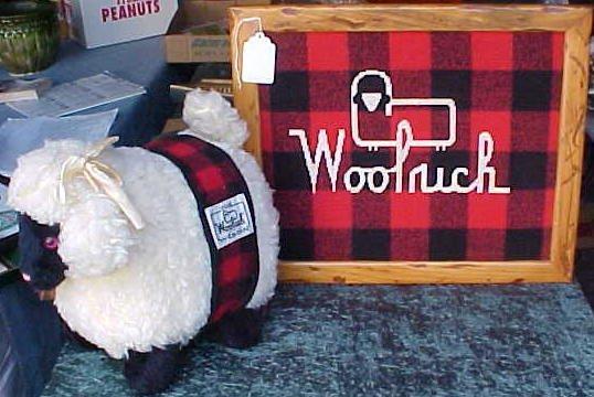 008: Framed Woolrich Fabric W/ Logo & Woolrich Lamb