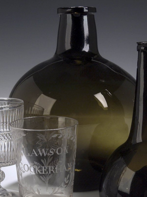 3: A late 18th century olive green glass wine
