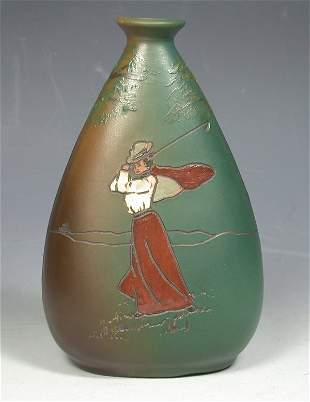 An early 20th century Weller 'Dickensware' pottery