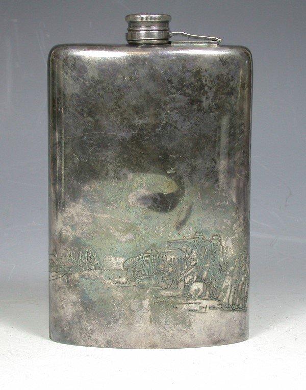 24: A Meriden Silver Plate Co. spirit flask,