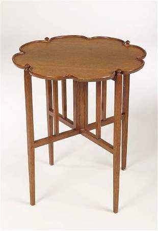 A Simpson of Kendal oak tray on stand, the tray o