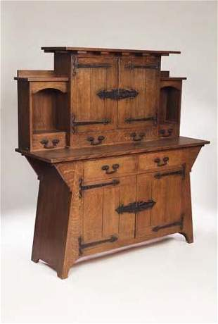 An Arts and Crafts oak sideboard, the superstruct