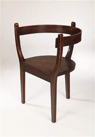 An Arts and Crafts oak tub chair, the curved back