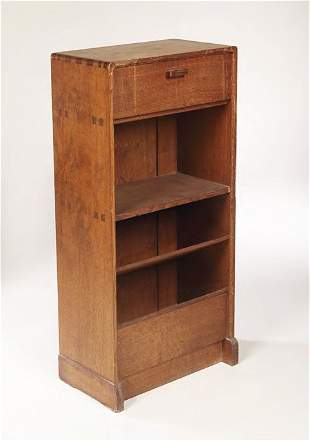 An Arts and Crafts oak bookcase cabinet, of recta