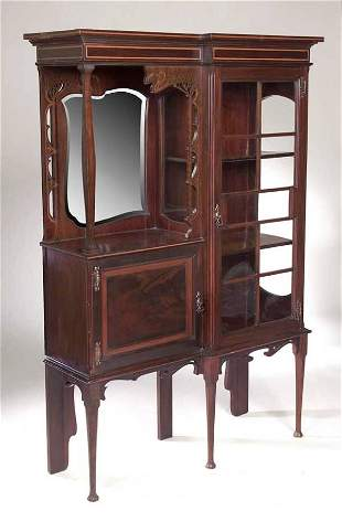 An Art Nouveau mahogany and inlaid display cabinet