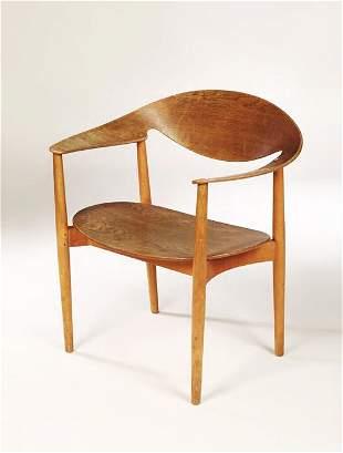 A Fritz Hansen teak open armchair, designed by Ej
