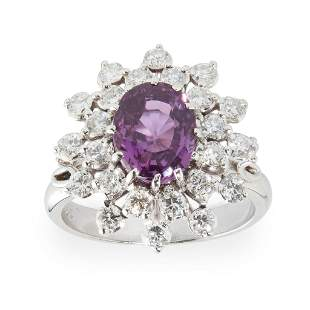 A pink sapphire and diamond set cluster ring
