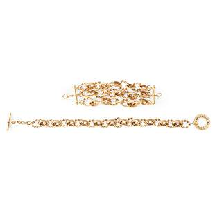 A gold-tone necklace and matching bracelet, Karl