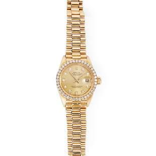 Rolex: a lady's 18ct gold wrist watch