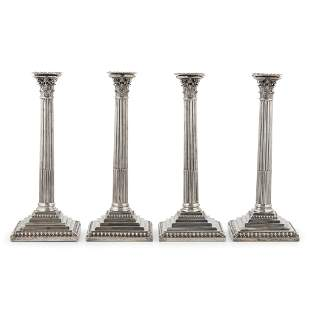 A set of four George III table candlesticks