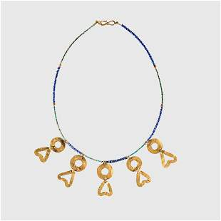 WESTERN ASIATIC LAPIS LAZULI NECKLACE WITH GOLD