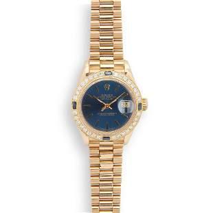 Rolex: a lady's gold wrist watch