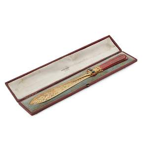 A VICTORIAN CASED GILT PAPER KNIFE RETAILED BY COCKBURN