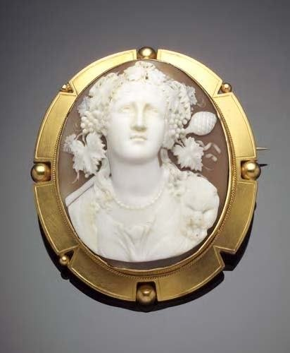 4: A large oval shell cameo brooch,  carved with a clas