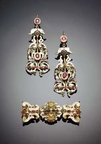 8: A matched gilt metal, ruby and enamelled suite,  com