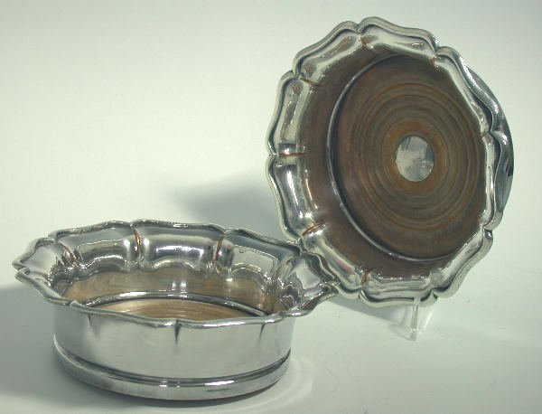 33: A pair of old Sheffield plate bottle coasters,  of