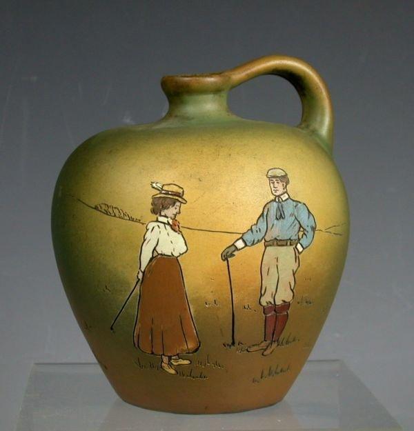 6: A Weller 'Dickensware' pottery jug,
