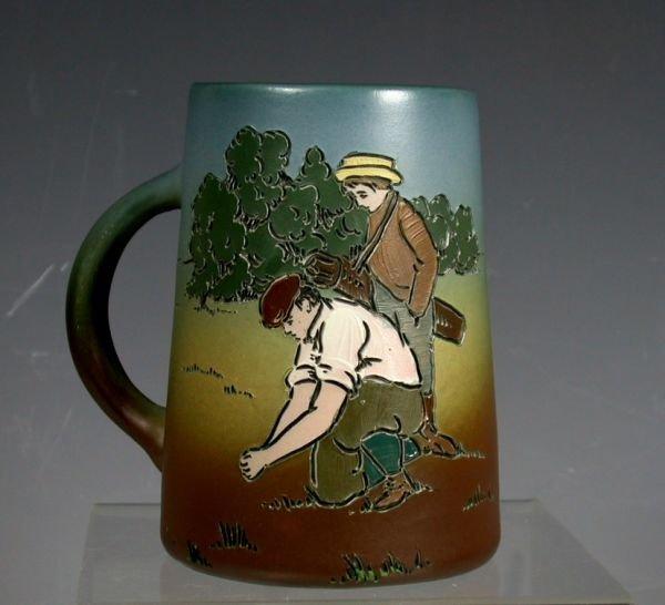 7: A Weller 'Dickensware' pottery mug,
