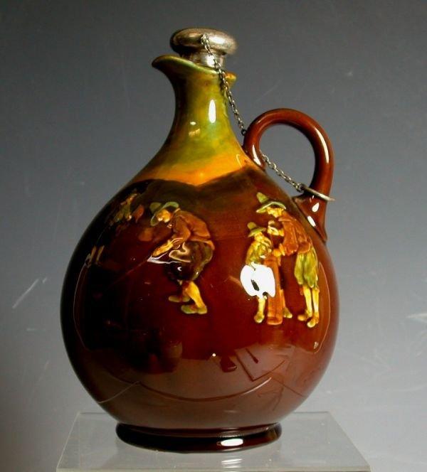 8: A Royal Doulton Kingsware jug and stopper,