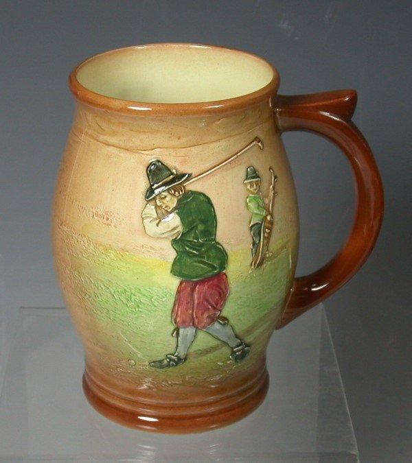 12: A Royal Doulton Kingsware mug,
