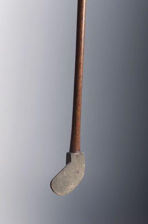 413: An unusual brass ball back iron,