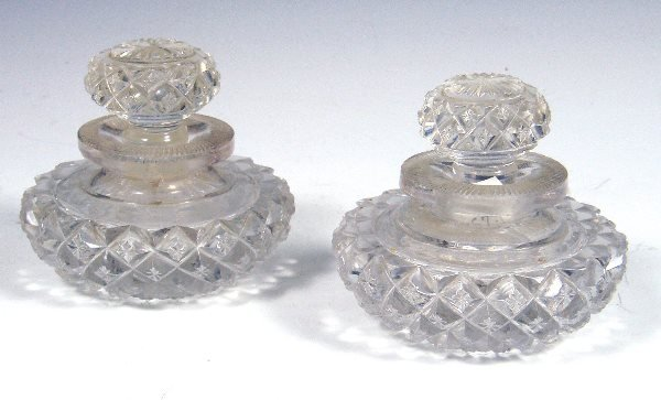 4: A pair of Victorian circular cut glass inkwells and