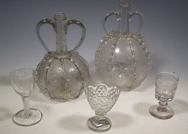 6: Two Dutch etched trail decorated twin handled flasks
