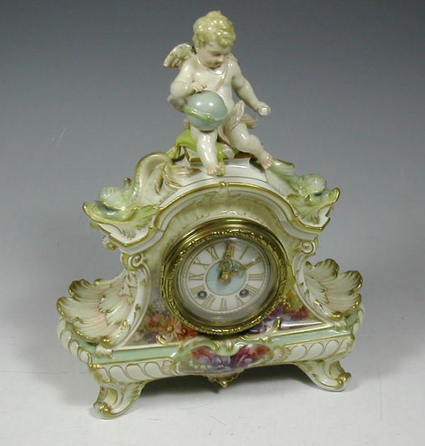 10: A Berlin porcelain mantel clock,the scrolling case