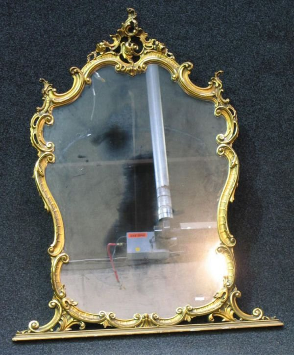 510: A gilt framed wall mirror,of serpentine form, with